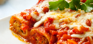 Delicious cannelloni with a rich tomato sauce, topped with melting cheese.